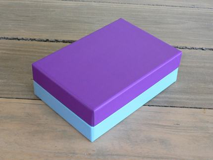 Shoulder box with lift off lid covered with matt laminated printed sheets