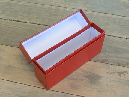 A tall narrow shoulder box covered in a leatherette style paper